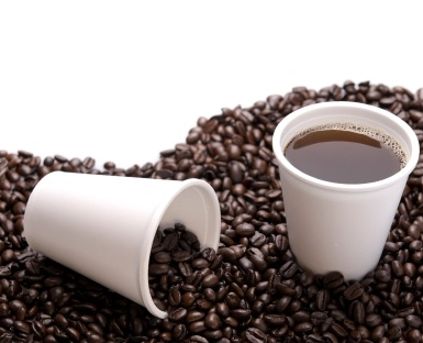coffee beans and styrofoam cup